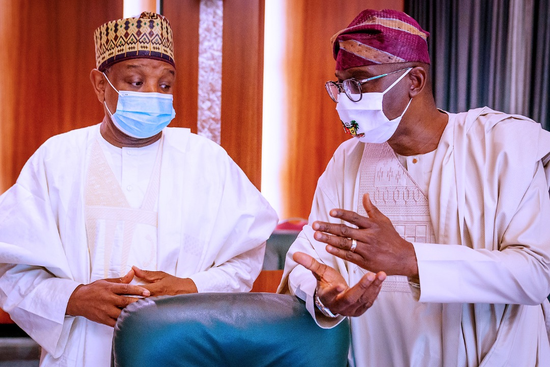 Lagos State Governor, Mr. Babajide Sanwo-Olu (right), in a discussion with Governor Atiku Bagudu of Kebbi State at the National Food Security Council meeting, Presidential Villa, Abuja, on Thursday, September 10, 2020.