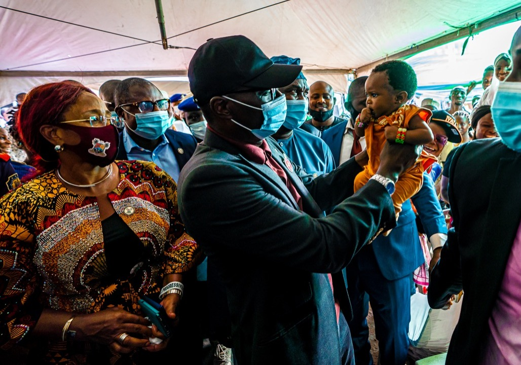 Lagos State Governor, Mr. Babajide Sanwo-Olu (middle) carries an infant; Deputy Governor, Dr. Obafemi Hamzat (right) and Commissioner for Works and Infrastructure, Mrs. Aramide Adeyoye (left), during the commissioning of Apapa Ignamu Primary Health Centre at Badia, Ijora, on Friday, November 27, 2020.